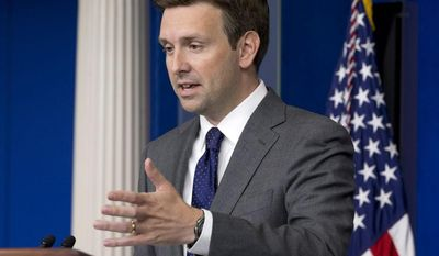 Joshua Earnest, White House deputy press secretary, speaks to the media in the briefing room of the White House in Washington on Thursday, Aug. 29, 2013. (AP Photo/Jacquelyn Martin)