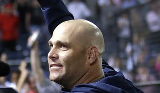 Atlanta Braves starting pitcher Tim Hudson waves to the crowd after the Braves defeated  the Washington Nationals 8-1 in a baseball game Tuesday, April 30, 2013, in Atlanta. The win was Hudson's 200th career victory.  (AP Photo/John Bazemore)