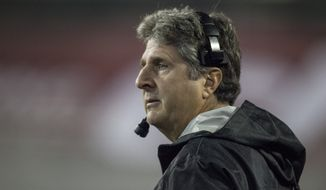 Washington State head coach Mike Leach watches his defense get ready for the next play against Oregon State during the first half of an NCAA college football game Saturday, Oct. 12, 2013, at Martin Stadium in Pullman, Wash. Oregon State won 52-24. (AP Photo/Dean Hare)