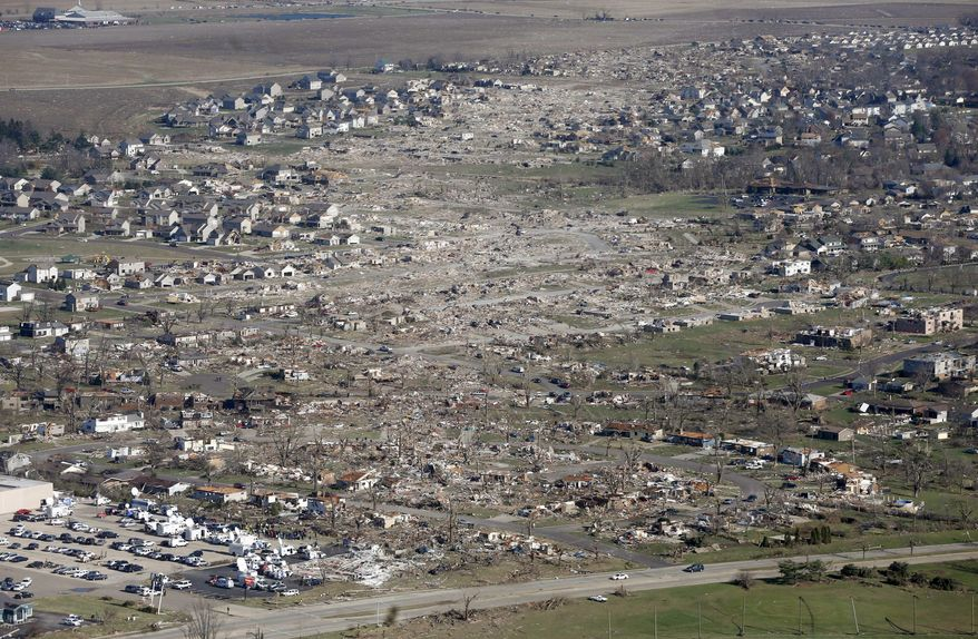 This aerial view on Monday, Nov. 18, 2013, shows the path of a tornado that hit the western Illinois town of Washington on Sunday. It was one of the worst-hit areas after intense storms and tornadoes swept through Illinois. The National Weather Service says the tornado that hit Washington had a preliminary rating of EF-4, meaning wind speeds of 170 mph to 190 mph. (AP Photo/Charles Rex Arbogast)