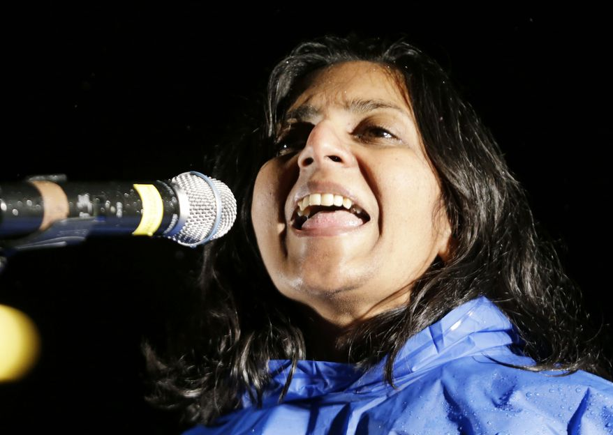 """Kshama Sawant, a socialist newly-elected to the Seattle city council, speaks at a """"Build it Here"""" rally Monday, Nov. 18, 2013, in downtown Seattle. The Washington State Labor Council called for the rally, saying it wanted to show Boeing and state leaders it supports Machinists union members who voted last week to reject contract concessions Boeing said it needed to build the new 777X in Washington. Organizers said that the Machinists deserve to not only build Boeing's next new plane in Washington but to share in the company's prosperity. Over the weekend at the Dubai Airshow, three Middle Eastern airlines signed up to buy 225 of the large, fuel-efficient widebodies in deals worth $95 billion. (AP Photo/Elaine Thompson)"""