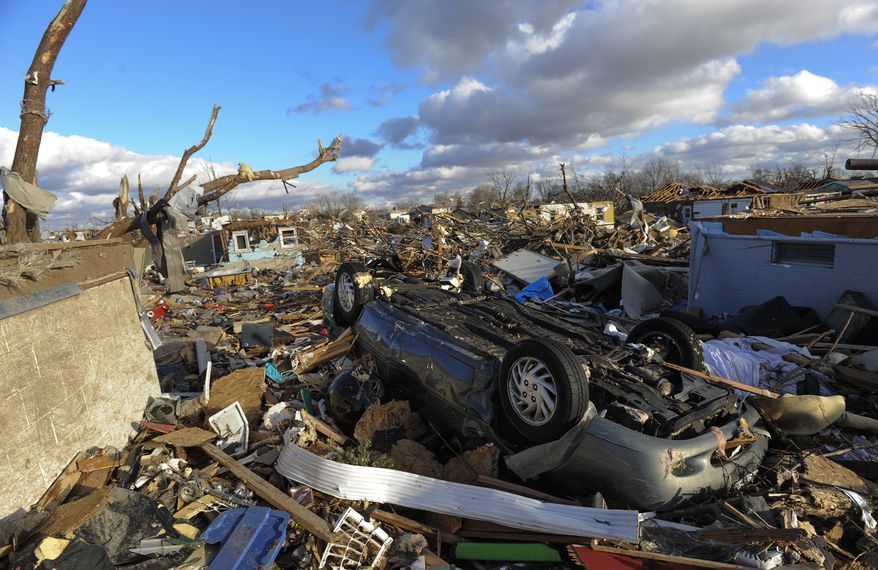 A neighborhood in the Devonshire subdivision of Washington, Ill., is left in ruins after a tornado tore through the northern part of the town on Sunday, Nov. 17, 2013. (AP Photo/Peoria Journal Star, Ron Johnson)