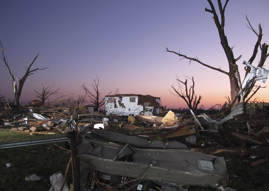 Debris from a row of homes destroyed by a tornado in Washington, Ill., is seen early Monday, Nov. 18, 2013. The tornado destroyed several hundred homes in the small town the day before. (AP Photo/David Mercer)