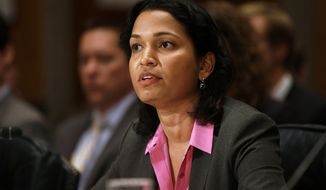 Mythili Raman, Acting Assistant Attorney General of the Criminal Division for the Dept. of Justice, testifies at a Senate Homeland Security and Governmental Affairs hearing about virtual currencies, such as bitcoin, on Capitol Hill in Washington on Monday Nov. 18, 2013. (AP Photo/Jacquelyn Martin)
