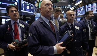 Traders work on the floor of the New York Stock Exchange Monday, Nov. 18, 2013. The Dow Jones industrial average crossed 16,000 points for the first time early Monday and the Standard & Poor's 500 index crossed 1,800 points. (AP Photo/Richard Drew)