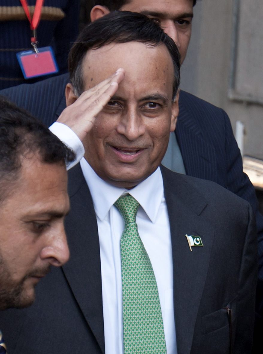 ** FILE ** In this Monday, Jan. 9, 2012, file photo, Pakistan's former ambassador to the U.S., Husain Haqqani salutes to media as he leaves after appearing before a judicial commission at a high court in Islamabad, Pakistan.  (AP Photo/Anjum Naveed, File)