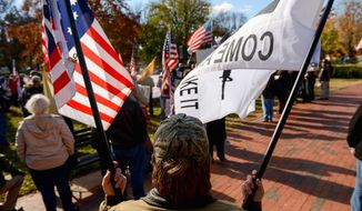 """Doug Allen of Greenville, N.C., holds a flag depicting an assault riffle with the words """"Come and Take It"""" as he joins protesters organized by the Reclaim America Now Coalition in Lafayette Square on Tuesday demanding President Obama's resignation. (andrew harnik/the washington times)"""