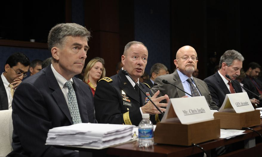 From left, Deputy National Security Agency Director Chris Inglis, National Security Agency Director Gen. Keith Alexander, Director of National Intelligence James Clapper and Deputy Attorney General James Cole, testifies on Capitol Hill in Washington, Tuesday, Oct. 29, 2013, before the House Intelligence Committee hearing on potential changes to the Foreign Intelligence Surveillance Act (FISA). Faced with anger over revelations about U.S. spying at home and abroad, members of Congress suggested Tuesday that programs the Obama administration says are needed to combat terrorism may have gone too far. (AP Photo/Susan Walsh)