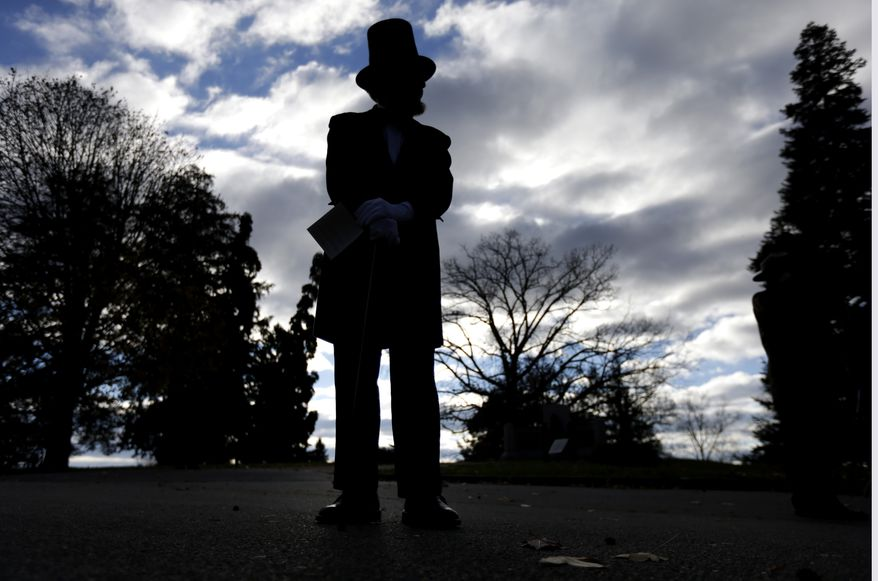 James Getty, portraying President Abraham Lincoln, stands before a ceremony commemorating the 150th anniversary of the dedication of the Soldiers' National Cemetery and President Abraham Lincoln's Gettysburg Address, Tuesday Nov. 19, 2013, in Gettysburg, Pa. Lincoln's speech was first delivered in Gettysburg nearly five months after the major battle that left tens of thousands of men wounded, dead or missing. Getty is scheduled to deliver the Gettysburg Address at Tuesday's ceremony. (AP Photo/Matt Rourke)