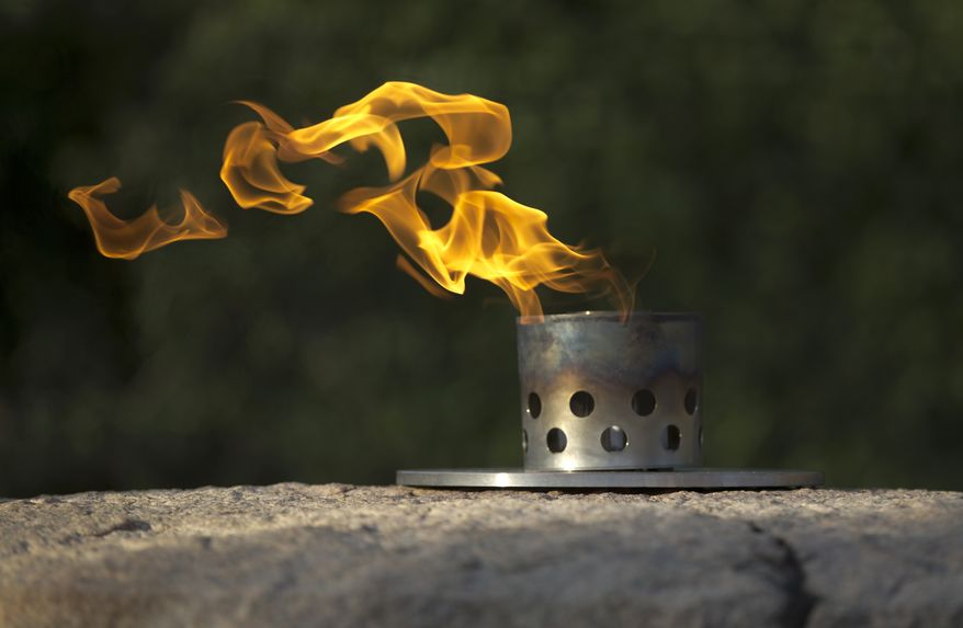 The eternal flame burns atop at the gravesite of President John F. Kennedy at Arlington National Cemetery in Arlington, Va., Tuesday, Nov. 19, 2013. Friday, Nov. 22 will mark the 50th anniversary of Kennedy's assassinated in Dallas.  (AP Photo/Carolyn Kaster)