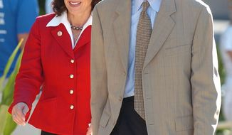 ** FILE ** Katherine Harris and her husband, Anders Ebbeson, arrive at their voting precinct in Longboat Key, Fla., on Sept. 5, 2006, to cast their ballots in the primary election. Mrs. Harris, who as Florida secretary of state came to national attention during the 2000 presidential election, was running for the U.S. Senate. (AP Photo/Steve Nesius)