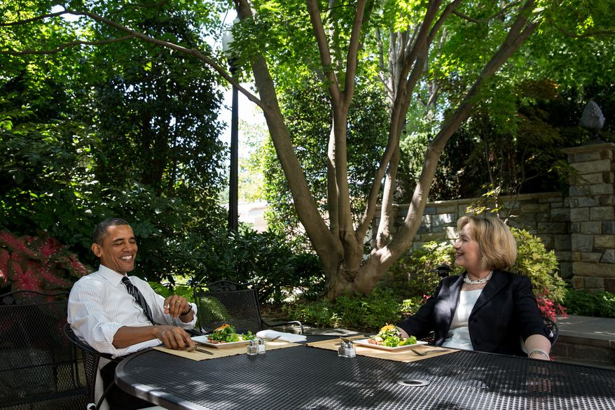 **FILE** President Obama has lunch with former Secretary of State Hillary Rodham Clinton on the patio outside the Oval Office on July 29, 2013. (Chuck Kennedy/White House)