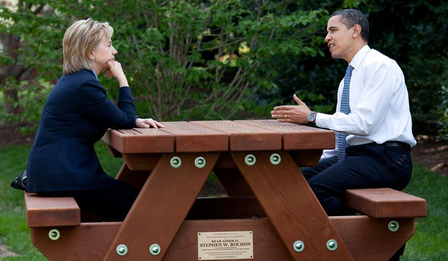 President Barack Obama and Secretary of State Hillary Rodham Clinton speak together sitting at a picnic table April 9, 2009, on the South Lawn of the White House. (Official White House Photo by Pete Souza)