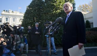 Sen. Bob Corker, R-Tenn., ranking Republican on the Senate Foreign Relations Committee, speaks to members of the media outside the West Wing of the White House in Washington, Tuesday, Nov. 19, 2013, following a meeting with President Barack Obama. The President met with chairmen, ranking members, as well as other members of the Senate Banking Committee, Senate Foreign Relations Committee, Senate Armed Services Committees, and Senate Select Committee on Intelligence regarding Iran. (AP Photo/Pablo Martinez Monsivais)