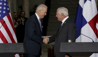 U.S. Vice President Joseph R. Biden (left) and Panamanian President Ricardo Martinelli shake hands after their meeting at the presidential palace in Panama City on Tuesday, Nov. 19, 2013. Mr. Biden is in Panama for an economic mission that will include touring the Panama Canal expansion project. (AP Photo/Arnulfo Franco)