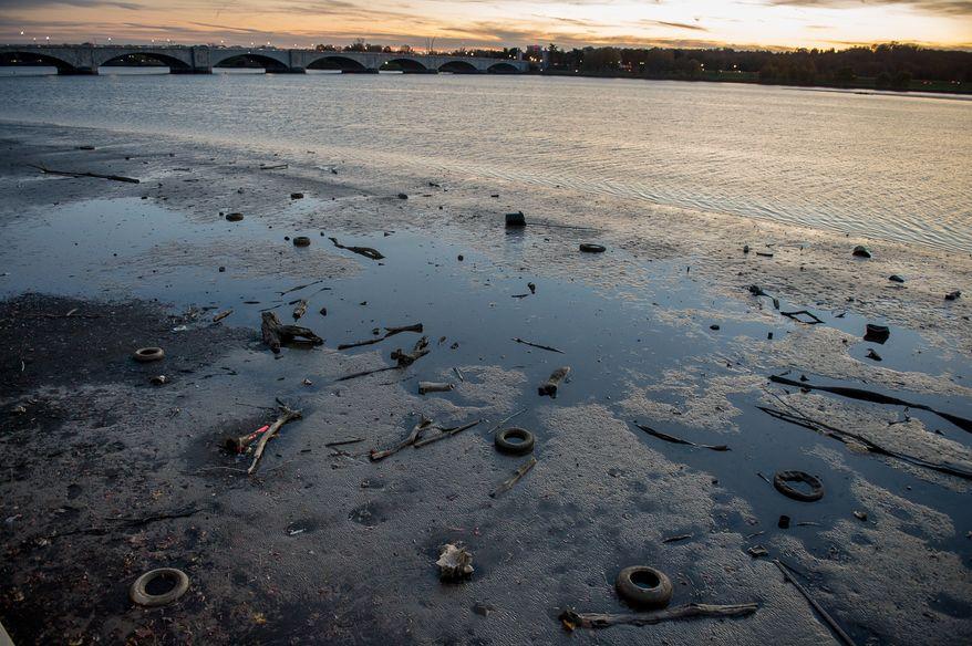 Tires and other debris floats in the Potomac River near Memorial Bridge, Washington, D.C., Tuesday, November 19, 2013. (Andrew Harnik/The Washington Times)