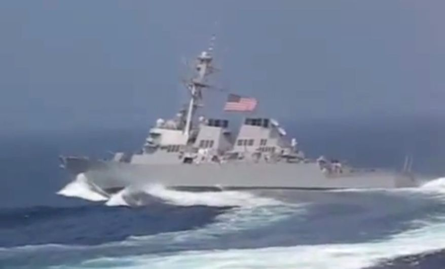 USS Gonzalez demonstrates its incredible maneuverability by executing a hair-pin turn for spectators in Norfolk, Virginia.