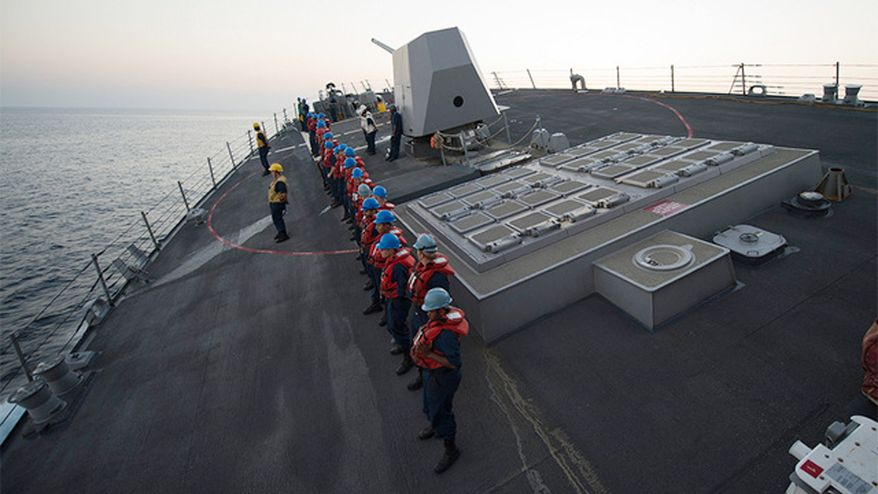 Photo by U.S. Navy photo by Mass Communication Specialist 3rd Class Shane A. Jackson shows sailors standing aboard a similar guided-missile destroyer USS Bulkeley during a turn at full speed.