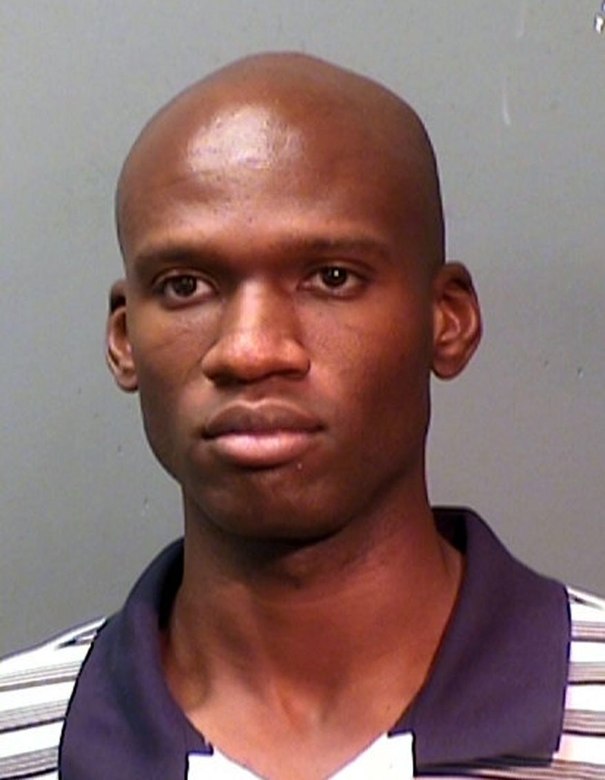 BACKGROUND: Aaron Alexis was arrested by Fort Worth, Texas, police on suspicion of discharging a firearm before he was granted a security clearance. (Associated Press)