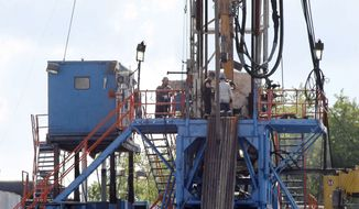 FILE - In this June 25, 2012 file photo, a crew works on a gas drilling rig at a well site for shale based natural gas in Zelienople, Pa. The Republican-controlled House is considering three energy bills aimed at speeding up drilling for oil and natural gas. Bills expected to win approval Wednesday would restrict the Interior Department from enforcing proposed rules to regulate hydraulic fracturing, or fracking, on public lands and set strict deadlines for federal approval of oil and gas permits. (AP Photo/Keith Srakocic, File)