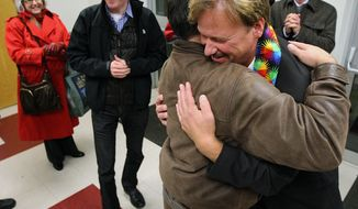 The Rev. Frank Schaefer, right, of Lebanon Pa., gets hug from supporter Andrew Monath, of New Hope Pa., after the sentencing phase of the trial at Camp Innabah, a United Methodist retreat, in Spring City Pa. Tuesday Nov. 19, 2013. A jury of his pastoral peers convicted Schaefer on Monday of breaking his vows by officiating his gay sons' Massachusetts wedding in 2007. Schaefer was given a 30 day suspension by the church.(AP Photo/Chris Knight)