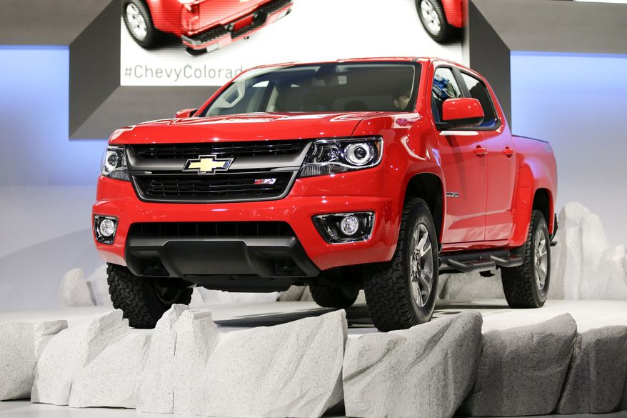 The new 2015 Chevrolet Colorado is introduced at the Chevrolet booth at the Los Angeles Auto Show on Wednesday, Nov. 20, 2013, in Los Angeles. (AP Photo/Jae C. Hong)