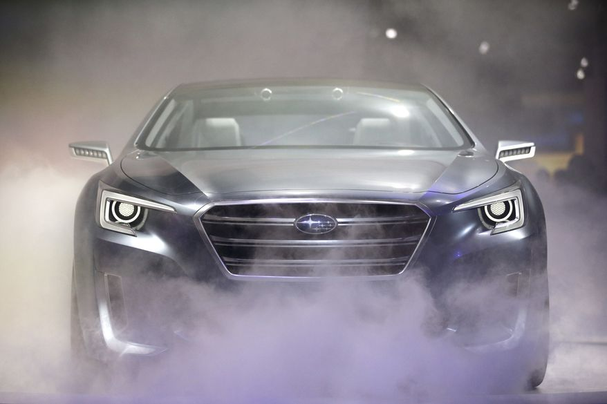The Subaru Legacy concept vehicle is introduced at the Los Angeles Auto Show on Wednesday, Nov. 20, 2013, in Los Angeles. (AP Photo/Jae C. Hong)