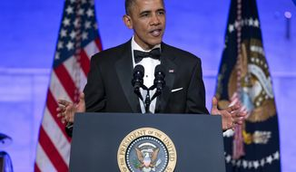 **FILE** President Barack Obama gestures as he speaks during a dinner in honor of the Presidential Medal of Freedom awardees at the Smithsonian Museum of American History on Wednesday, Nov. 20, 2013 in Washington. (AP Photo/ Evan Vucci)