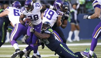 Adrian Peterson #28 of the Minnesota Vikings, in action, in the first quarter, in a game against the Seattle Seahawks at Century Link Field during an NFL  game in Seattle on Sunday Nov. 17, 2013. (AP Photo/David Seelig)