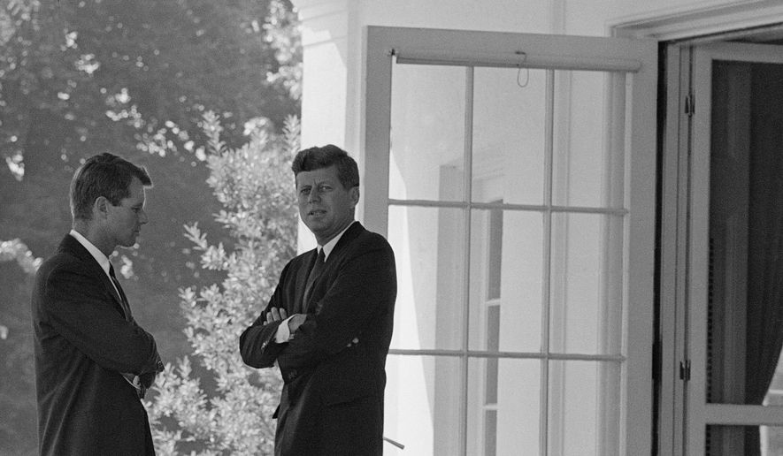 President Kennedy confers with his brother Attorney General Robert F. Kennedy in 1962 during the buildup of tensions with the Soviet Union that became Cuban Missile Crisis. (Associated Press) ** FILE **