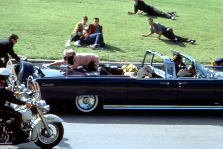 """This image provided by Warner Bros. from Oliver Stone's 1991 movie """"JFK"""" shows a recreation of the assassination of U.S. President John F. Kennedy in Dallas. """"This murder in broad daylight ... Everything changed,"""" says Stone, the Baby Boomer director who served in Vietnam and made a movie about it before turning his critical lens on the Kennedy assassination. (AP Photo/Warner Bros.)"""