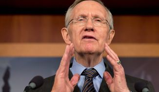 "Pressing the button: ""It's time to change the Senate before this institution becomes obsolete,"" Senate Majority Leader Harry Reid said Thursday. (Associated Press)"
