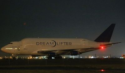 A Boeing 747 Dreamlifter sits on the runway after accidentally landing at Col. James Jabara Airport in Wichita, Kan., instead of the nearby McConnell Air Force Base on Wednesday, Nov. 20, 2013. (AP Photo/Wichita Eagle, Jaime Green)