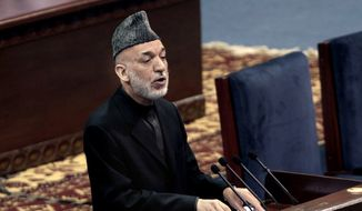 Afghan President Hamid Karzai speaks during the first day of the Loya Jirga in Kabul, Afghanistan, Thursday, Nov. 21, 2013. Karzai has told a gathering of elders that he supports signing a security deal with the United States if safety and security conditions are met. Karzai spoke as the 2,500-member national consultative council of Afghan elders known as the Loya Jirga started in Kabul on Thursday. The four-day meeting will discuss the bilateral security pact that defines the role of thousands of U.S. troops who will remain after the NATO combat mission ends in 2014. (AP Photo/Rahmat Gul)