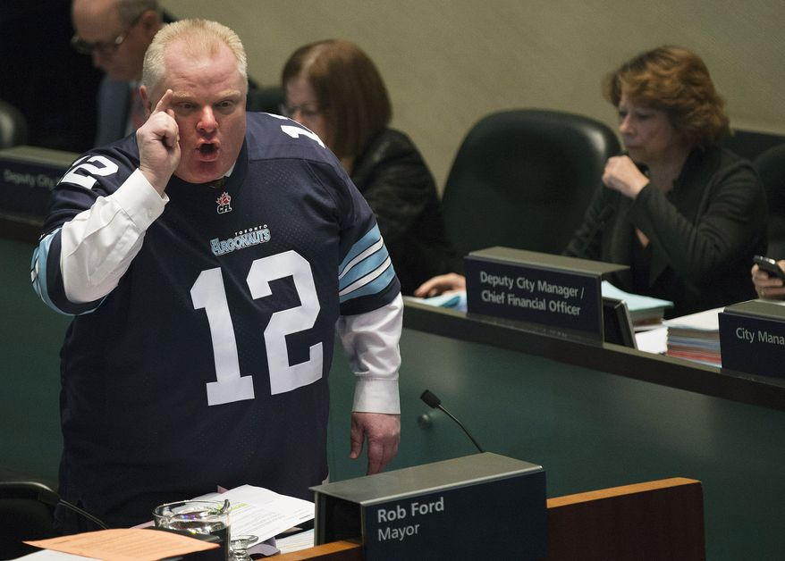 **FILE** Mayor Rob Ford speaks to city council members about new allegations against him in Toronto on Thursday, Nov. 14, 2013. Ford is threatening to take legal action against former aides who told police about their concerns about his drug use and drunken driving. He also denies making sexual advances toward a female staffer. (Associated Press/The Canadian Press, Nathan Denette)