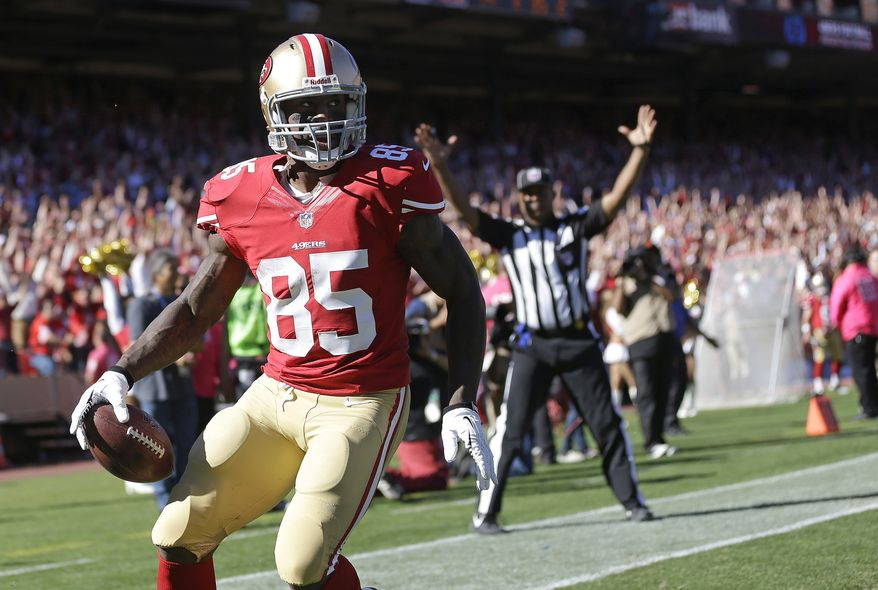 San Francisco 49ers tight end Vernon Davis (85) celebrates after scoring on a 35-yard touchdown reception during the second quarter of an NFL football game against the Arizona Cardinals in San Francisco, Sunday, Oct. 13, 2013. (AP Photo/Marcio Jose Sanchez)