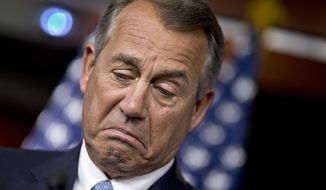 House Speaker John A. Boehner, Ohio Republican, pauses while meeting with reporters on Capitol Hill in Washington on Thursday, Nov. 21, 2013, before Congress leaves for a two-week Thanksgiving break. (AP Photo/J. Scott Applewhite)