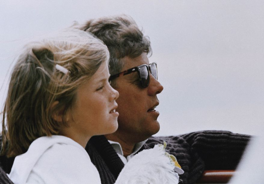 FILE - In this 1962 file photo, President John F. Kennedy and his daughter, Caroline, sail off Hyannis Port, Mass. (AP Photo)