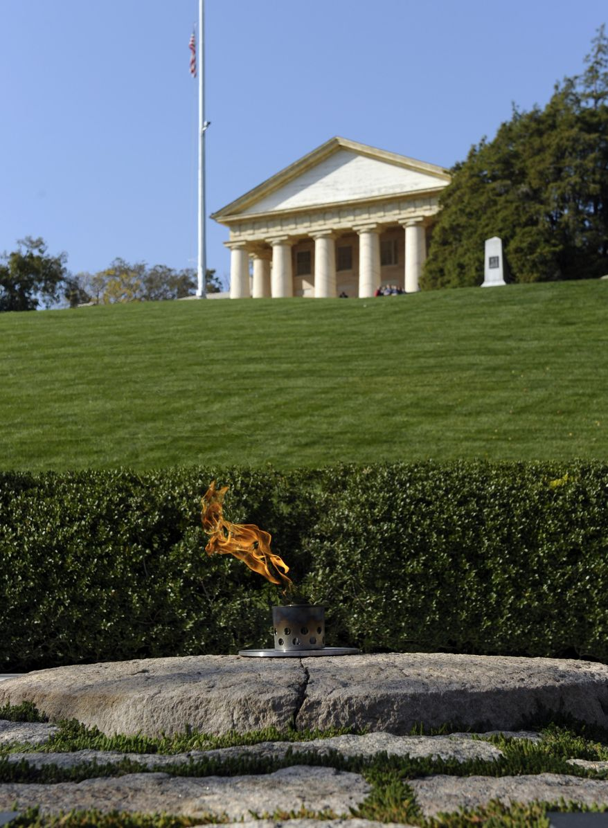 FILE - In this Tuesday, Oct. 29, 2013 file photo, Arlington House sits atop a hill overlooking the eternal flame at the grave site of President John F. Kennedy at Arlington National Cemetery in Arlington, Va. (AP Photo/Susan Walsh, File)