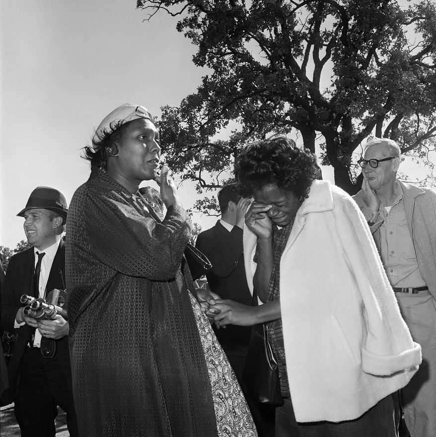 FILE - In this Friday, Nov. 22, 1963 file photo, women burst into tears outside Parkland Hospital upon hearing that President John F. Kennedy died from a shooting while riding in a motorcade in Dallas. (AP Photo/File)