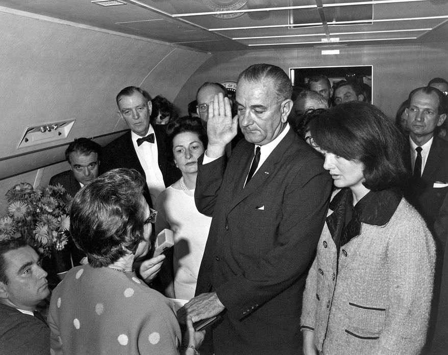 ADVANCE FOR USE SUNDAY, NOV. 17, 2013 AND THEREAFTER - FILE - In this Friday, Nov. 22, 1963 photo from the White House via the John Fitzgerald Kennedy Library in Boston, Lyndon B. Johnson is sworn in as president as Jacqueline Kennedy stands at his side in the cabin of the presidential plane on the ground at Love Field in Dallas. Judge Sarah T. Hughes, a Kennedy appointee to the Federal court, left, administers the oath. In background, from left are, Associate Press Secretary Malcolm Kilduff, holding microphone; Jack Valenti, administrative assistant to Johnson; Rep. Albert Thomas, D-Texas.; Lady Bird Johnson; and Rep. Jack Brooks, D-Texas. (AP Photo/White House, Cecil Stoughton, via the John Fitzgerald Kennedy Library, Boston)