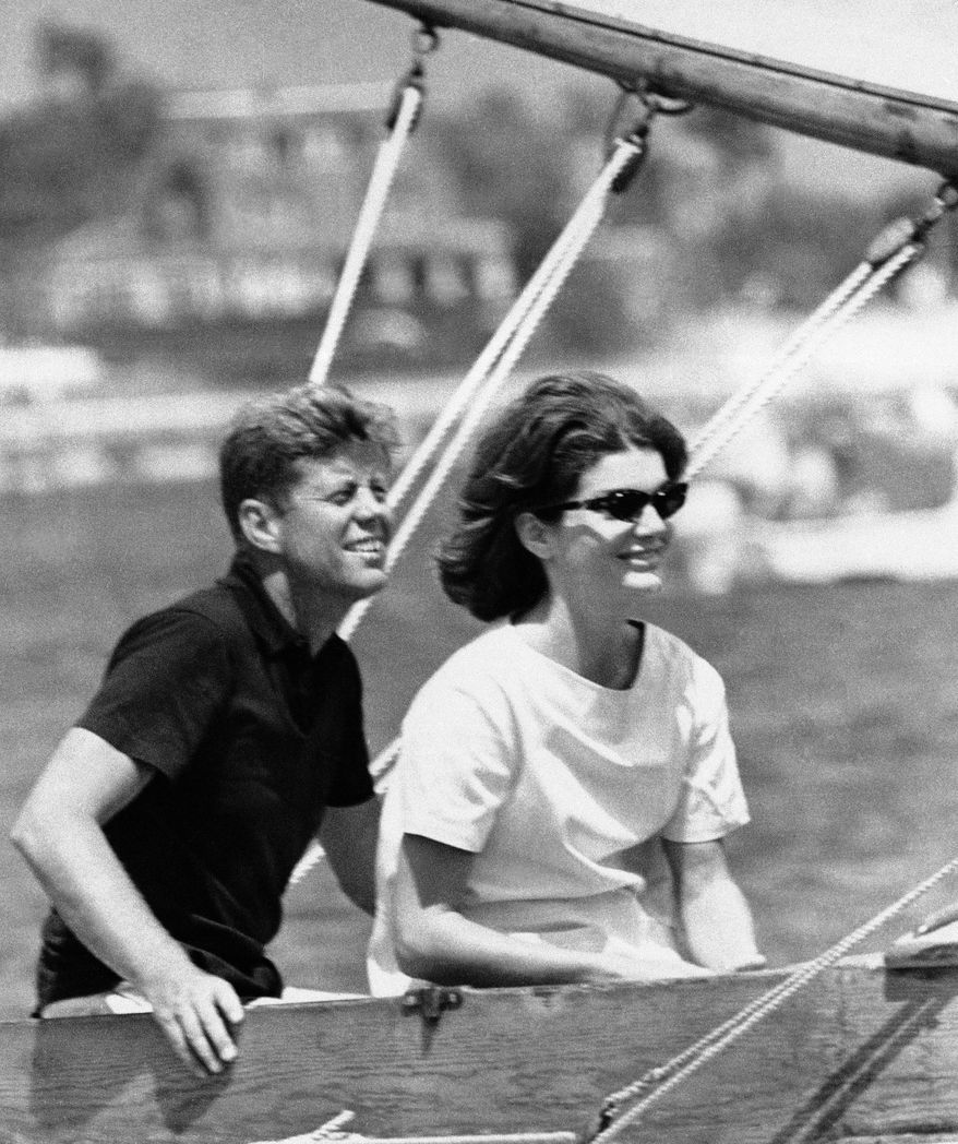 FILE - In this Aug. 7, 1960 file photo, Democratic presidential nominee Sen. John Kennedy and wife Jacqueline sit in their sailboat in Hyannis Port, Mass. (AP Photo)