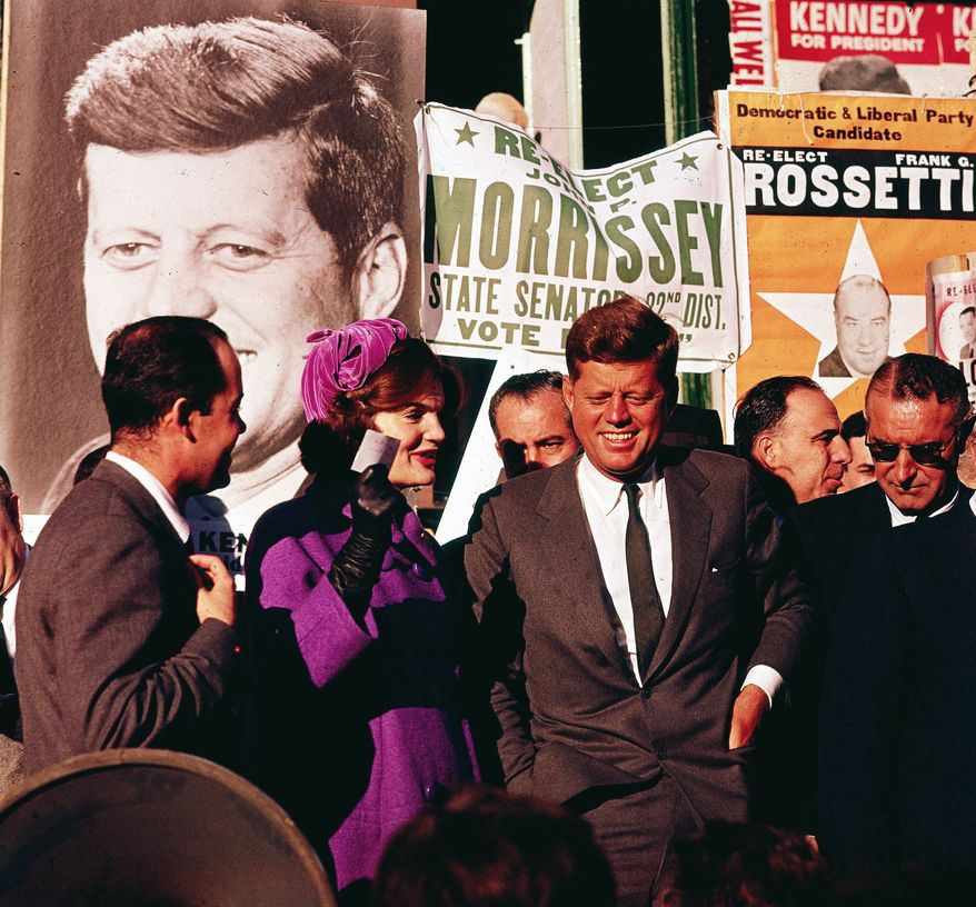 "FILE - In this October 1960 file photo Sen. John F. Kennedy and his wife, Jacqueline Kennedy, campaign in New York. The Kennedy image, the ""mystique"" that attracts tourists and historians alike, did not begin with his presidency and is in no danger of ending 50 years after his death. Its journey has been uneven, but resilient - a young and still-evolving politician whose name was sanctified by his assassination, upended by discoveries of womanizing, hidden health problems and political intrigue, and forgiven in numerous polls that place JFK among the most beloved of former presidents. (AP Photo)"