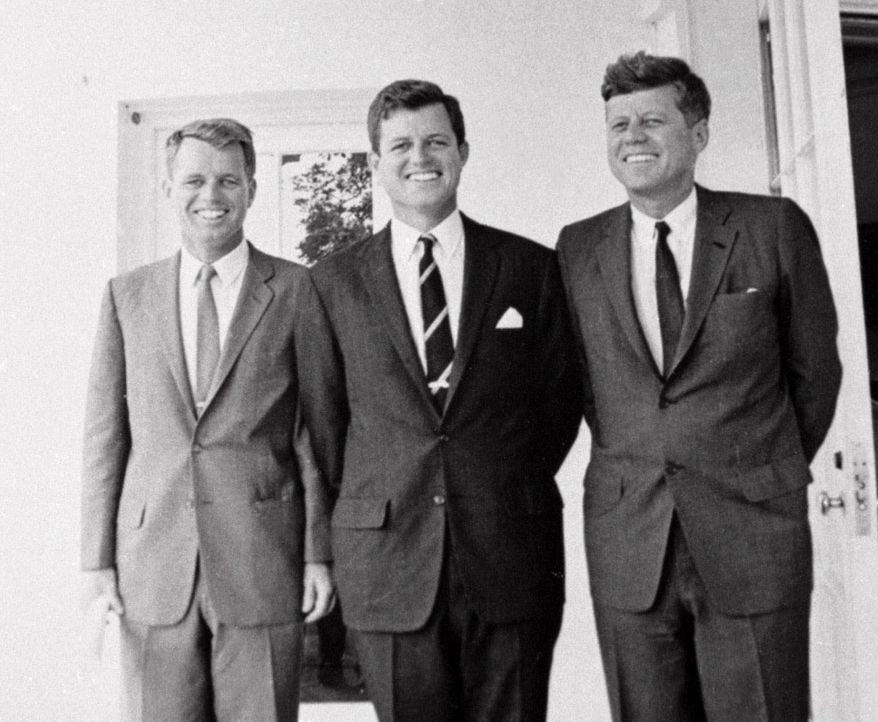 "FILE -  In this Aug.23, 1963 file photo, Sen. Edward M. Kennedy, D-Mass., center, poses with his brothers U. S. Attorney General Robert F. Kennedy, left, and President John F. Kennedy at the White House in Washington.  The Kennedy image, the ""mystique"" that attracts tourists and historians alike, did not begin with his presidency and is in no danger of ending 50 years after his death. Its journey has been uneven, but resilient _ a young and still-evolving politician whose name was sanctified by his assassination, upended by discoveries of womanizing, hidden health problems and political intrigue, and forgiven in numerous polls that place JFK among the most beloved of former presidents. (AP Photo)"