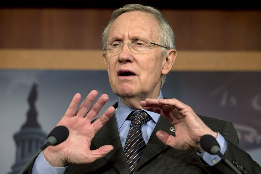 ** FILE ** Senate Majority Leader Harry Reid, D-Nevada, speaks to the media after the Democrat majority in the Senate pushed through a major rules change, one that curbs the power of the Republican minority to block President Barack Obama's nominations for high-level judgeships and cabinet and agency officials, on Capitol Hill on Thursday, Nov. 21, 2013, in Washington. (AP Photo/Jacquelyn Martin)