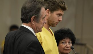 **FILE** Colorado Avalanche goalie Semyon Varlamov, standing between his attorney Jack Rotole, left, and a Russian interpreter, appears in court in Denver on Thursday, Oct. 31, 2013. Varlamov will be able to travel with the team while prosecutors consider whether he should be charged with assaulting his girlfriend. On Thursday, a judge said Varlamov could be released if he posted $5,000 bond and be allowed to travel with the team but he was ordered to stay away from his girlfriend, among other restrictions. (AP Photo/The Denver Post, RJ Sangosti, Pool)