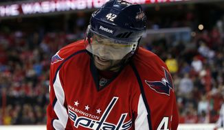 Washington Capitals right wing Joel Ward (42) reacts after missing a shot on goal in the third period of an NHL hockey game against the Montreal Canadiens, Friday, Nov. 22, 2013, in Washington. The Canadiens won 3-2. (AP Photo/Alex Brandon)