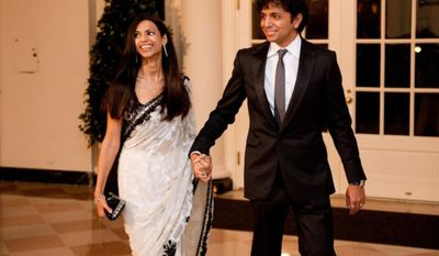 ** FILE ** M. Night Shyamalan and his wife Bhavna Shyamalan arrive for the State Dinner in honor of the Prime Minister of India at the White House in Washington, D.C., Tuesday, Nov. 24, 2009. (Michael Connor/The Washington Times)