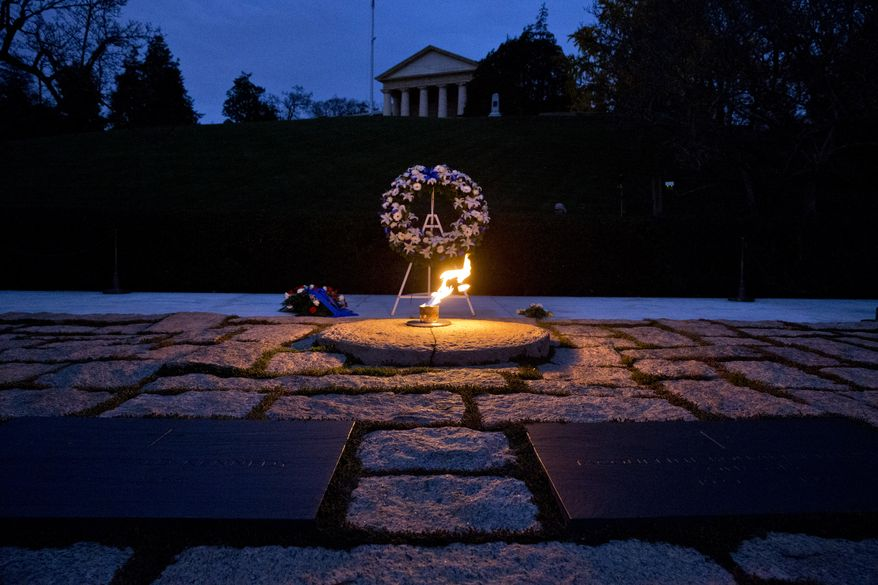 The eternal flame shines in the early morning light at the grave of John F. Kennedy at Arlington National Cemetery on Friday, Nov. 22, 2013, on the 50th anniversary of Kennedy's death. (AP Photo/Jacquelyn Martin)