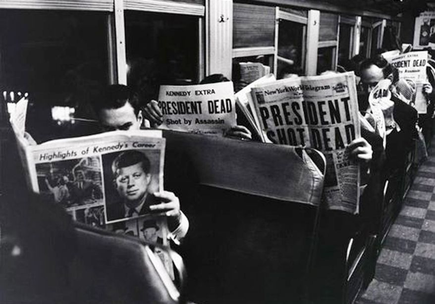 Photographer Carl Mydans of LIFE magazine snapped this photo of commuters on a train reading about the news of Kennedy's assassination.
